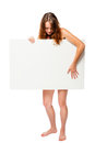 Woman with a poster covering her nakedness on a white Royalty Free Stock Photo