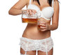 Woman pour whiskey in underwear isolated on white background Stock Photos
