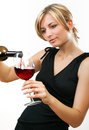 Woman pouring a glass of red wine Royalty Free Stock Photos