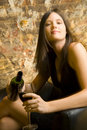 Woman pouring glass of wine Royalty Free Stock Image