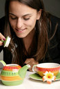 Woman pouring herself a cup of tea Royalty Free Stock Photo