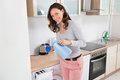 Woman Pouring Liquid Detergent In The Bottle Cap Royalty Free Stock Photo