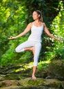 Woman Practacing Yoga In Nature