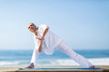 Woman practice yoga beautiful mid age on beach Royalty Free Stock Photos