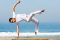 Woman practicing capoeira healthy young on the beach Royalty Free Stock Photography