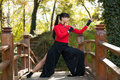 Woman Practicing Martial Arts in Woods Stock Photo