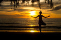 Woman practicing yoga on beach at sunset Royalty Free Stock Photos