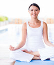 Woman practicing yoga beautiful looking very happy Royalty Free Stock Photography