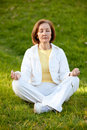 Woman practicing yoga outdoors Royalty Free Stock Photos