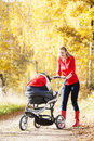 Woman with a pram Royalty Free Stock Photo