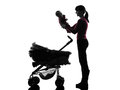 Woman prams holding baby silhouette one caucasian women on white background Stock Photo