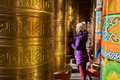 Woman and prayer wheel a female photographer by the in the tibetan magnificent temples when she walking through take on kangding Stock Images
