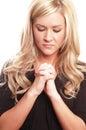 Woman praying Royalty Free Stock Photos