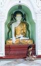 Woman praying on the area of the shwedagon pagoda in yangon myanmar january myanmar Stock Photo