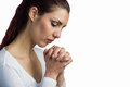 Woman praying with joining hands and eyes closed against white background Royalty Free Stock Photo