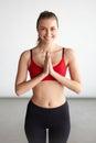 Woman praying or practising yoga Royalty Free Stock Photo