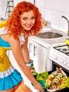 Woman prepare fish in oven happy Stock Photography