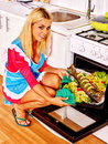 Woman prepare fish in oven happy grill Royalty Free Stock Photos