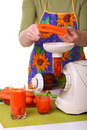 Woman prepare Juice extractor and carrot Stock Images