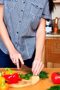 Woman prepares a salad at kitchen Royalty Free Stock Image