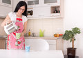 Woman preparing coffee young beautiful housewife in the kitchen pouring boiled water from electric boiler into cup Stock Photo