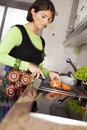 Woman preparing food at the kitchen Stock Photography