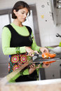 Woman preparing food at the kitchen modern some healthy her selective focus with shallow dof Stock Image