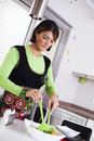 Woman preparing food at the kitchen modern some healthy her selective focus with shallow dof Royalty Free Stock Photos