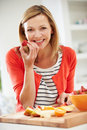 Woman Preparing Fruit Salad In Kitchen Royalty Free Stock Photo
