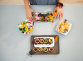 Woman preparing horribly halloween treats for party. Closeup Royalty Free Stock Photo