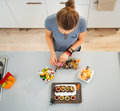 Woman preparing horribly tasty treats for halloween party Royalty Free Stock Photo