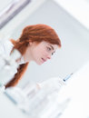Woman preparing injection close up of a in a laboratory an and being concentrated Stock Photography