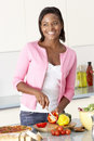 Woman Preparing Meal In Kitchen Royalty Free Stock Photo