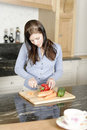 Woman preparing a meal in the kitchen beautiful young ingredients for her Stock Photography