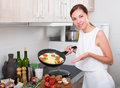 Woman preparing omelet in pan Royalty Free Stock Photo