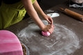 Woman preparing pink fondant for cake decorating, hands detail Royalty Free Stock Photo