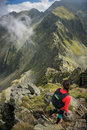 Woman preparing to embark on a dangerous scrambling trail in the mountains of romania Stock Photography