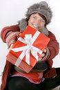Woman with present happily smiling offering a christmas Royalty Free Stock Photography