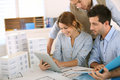 Woman presenting project to architects team of working in office Stock Photo