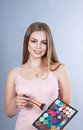 Woman with professional make up artist makeup kits cosmetics Royalty Free Stock Image