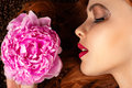 Woman profile face with peony on coffee beans Royalty Free Stock Photo