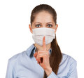 Woman in protective medical mask with a finger to his mouth Stock Photography
