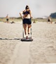 Woman pulling crossfit sled on a beach Royalty Free Stock Photos