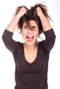 Woman pulling her hair and screaming Stock Photo