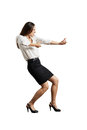 Woman pulling invisible rope screaming businesswoman isolated on white background Stock Photo