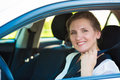Woman pulling on seat belt inside her car Royalty Free Stock Photo