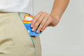 Woman pulls out of her pocket a plastic cards Royalty Free Stock Photo
