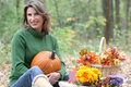 Woman with Pumpkin in park: fall, autumn Royalty Free Stock Photos
