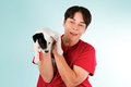 Woman with puppy in a red shirt holding a jack russell Royalty Free Stock Photos