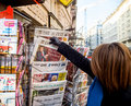 Woman purchases a Die Zeit german newspaper from a newsstand Royalty Free Stock Photo